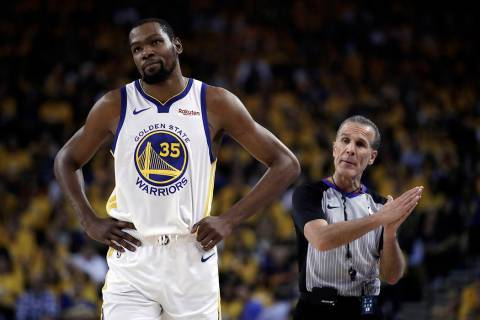 In this Wednesday, May 8, 2019, file photo, Golden State Warriors' Kevin Durant, left, walks aw ...