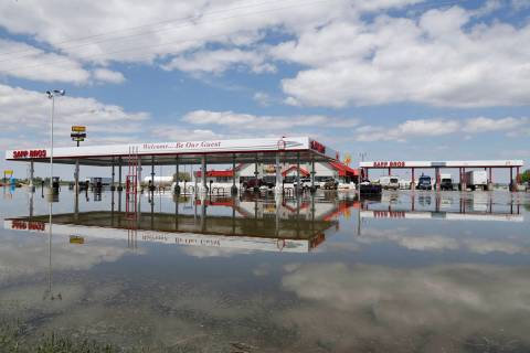 A Sapp Bros. gas station in Percival, Iowa, stands in floodwaters from the Missouri River, Frid ...