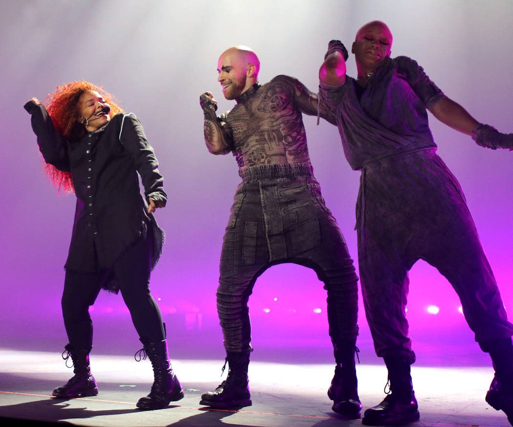 Janet Jackson (L) performs onstage during the opening night of her Metamorphosis - The Las Vega ...