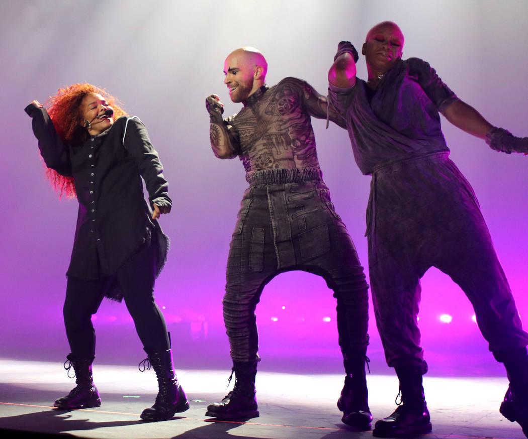Janet Jackson (L) performs onstage during the opening night of her Metamorphosis - The Las Vega ...