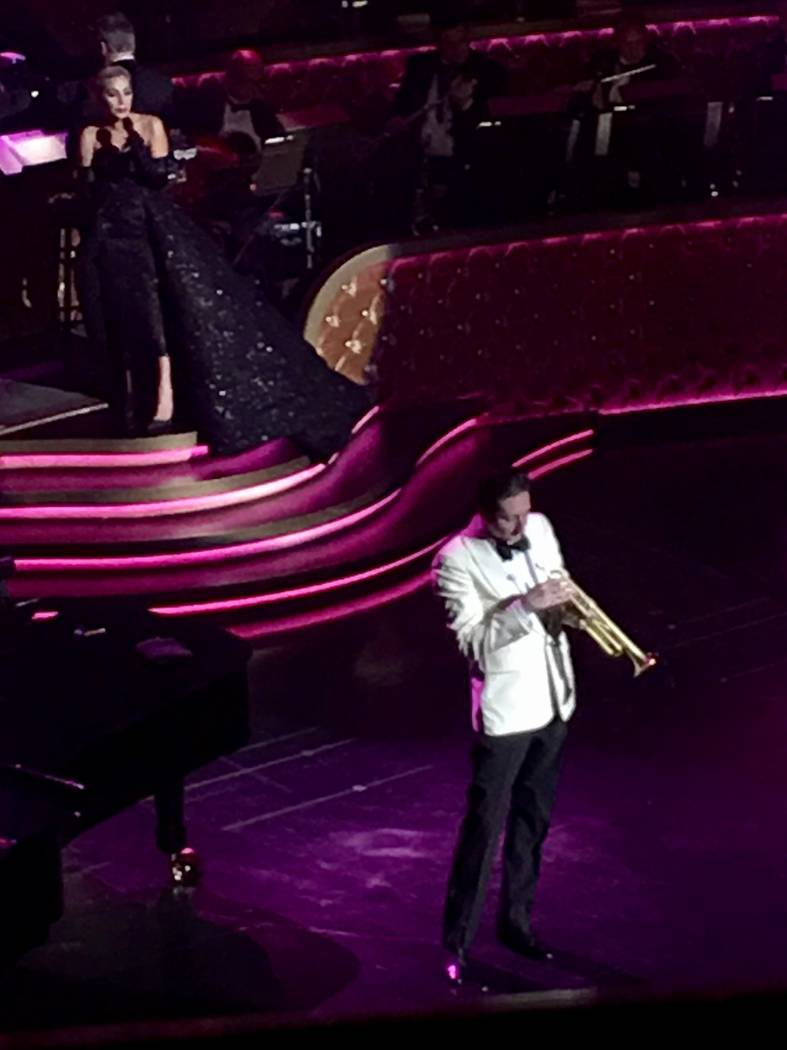 Lady Gaga sings behind the trumpet artistry of Brian Newman during her appearance at Encore Th ...
