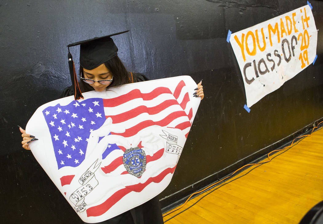 Cassandra Sosa shows off her winning mural during a graduation ceremony rehearsal at Chaparral ...