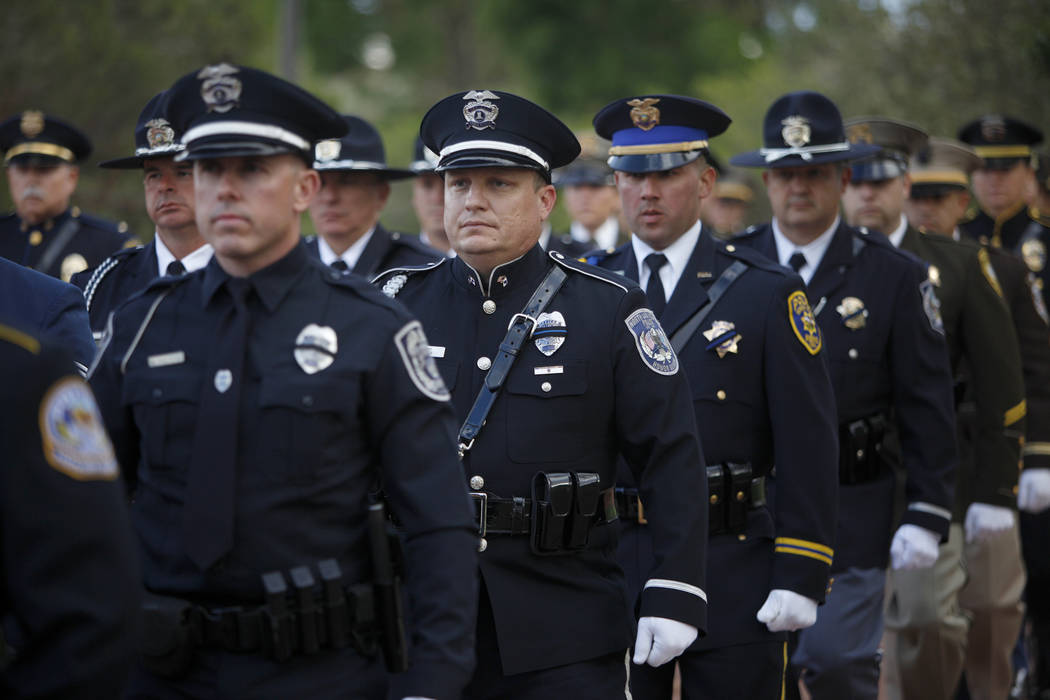The honor guard walks to the front of the Southern Nevada Law Enforcement Officers memorial ser ...
