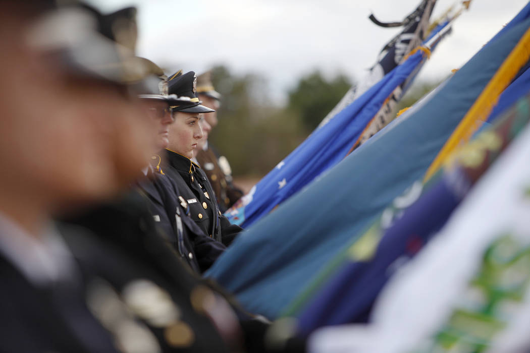 The flag detail stands over the crowd at the Southern Nevada Law Enforcement Officers memorial ...