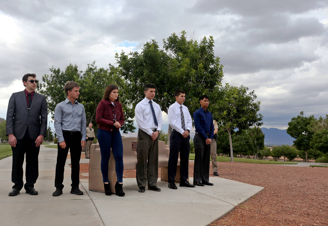 Students with parents who are active-duty LVMPD police and corrections officers line up to rece ...