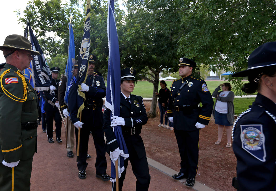 The flag detail walks toward the stage at the Southern Nevada Law Enforcement Officers memorial ...