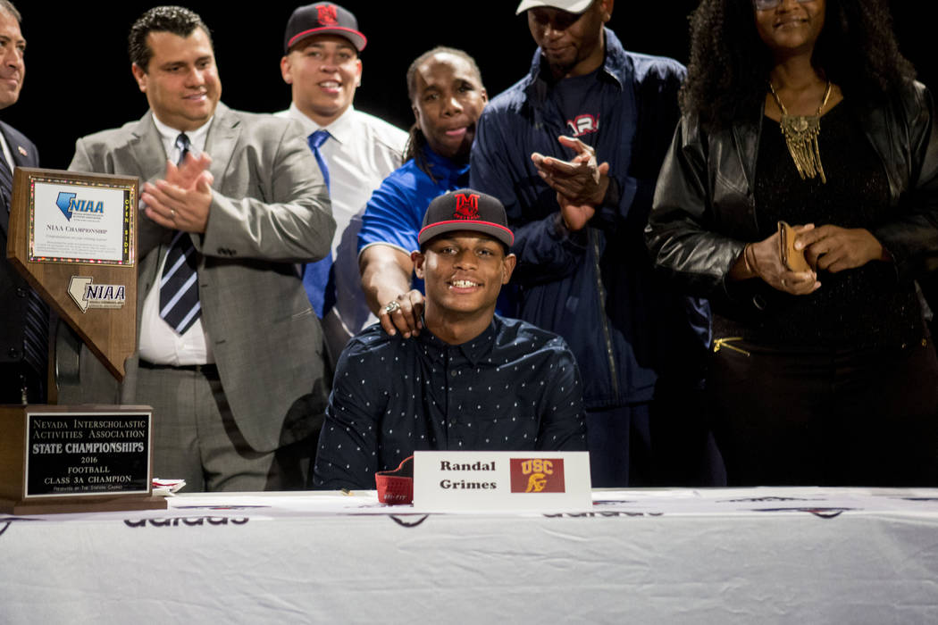 Senior Randal Grimes signs to play college football for University of Southern California at De ...