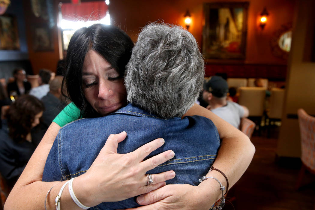 "Courtney Kaplan, left, mother of Michael ""Mikie"" Sigler, the Cimarron-Memorial High S ..."