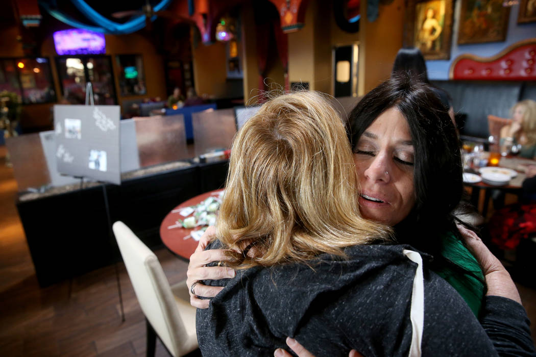 "Courtney Kaplan, right, mother of Michael ""Mikie"" Sigler, the Cimarron-Memorial High ..."