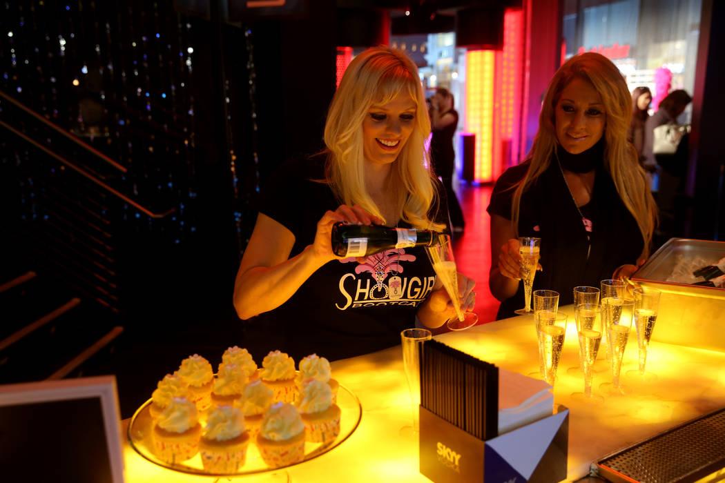 Coaches Dar Brzezinski, left, and Gabriella Versace prepare for a preview class of Showgirl Boo ...