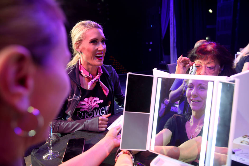 Coach Jennifer Jordan, center, works on makeup with Tammy Wadsworth of Henderson, left, and Git ...
