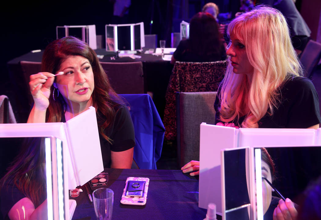 Coache Dar Brzezinski, right, works on makeup with Glenda Damien of Las Vegas during a preview ...