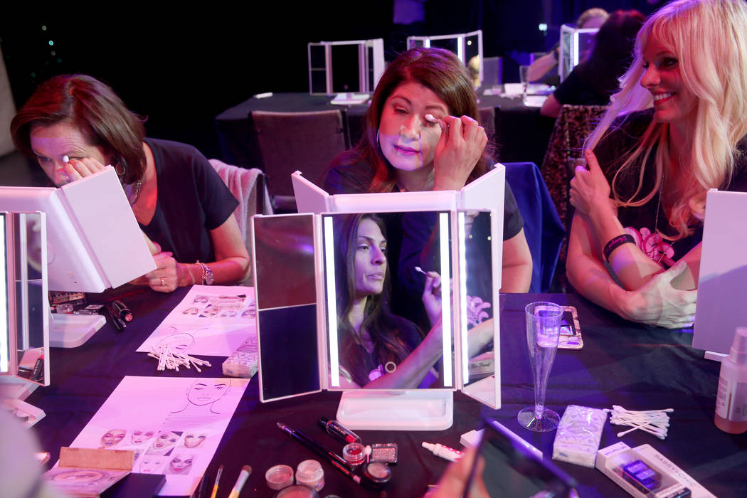 Coach Dar Brzezinski, right, works on makeup with Glenda Damien, center, and Marla Laughlin, bo ...