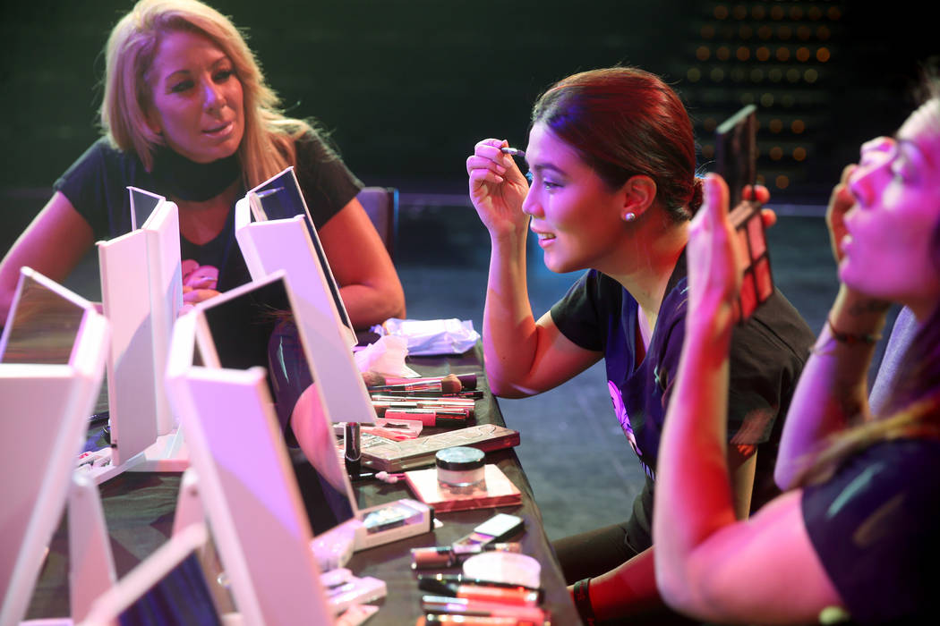 Coache Gabriella Versace, left, works on makeup with Marianne Tanada of Henderson during a prev ...