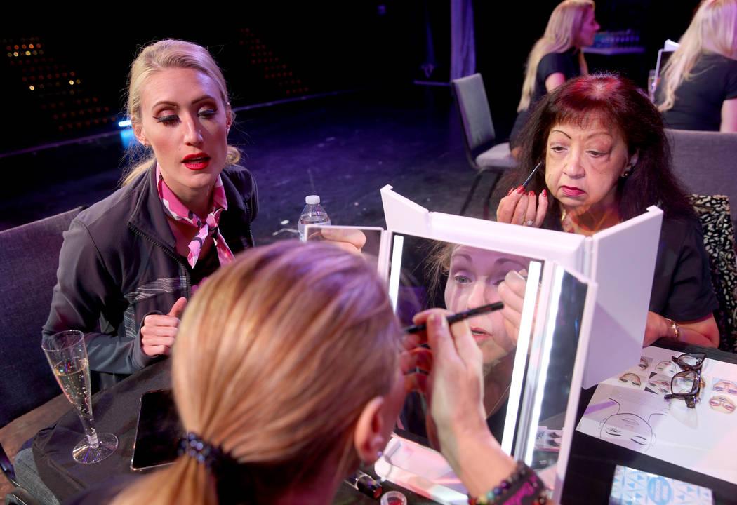 Coach Jennifer Jordan, left, works on makeup with Tammy Wadsworth, center, and Gita Saval, both ...