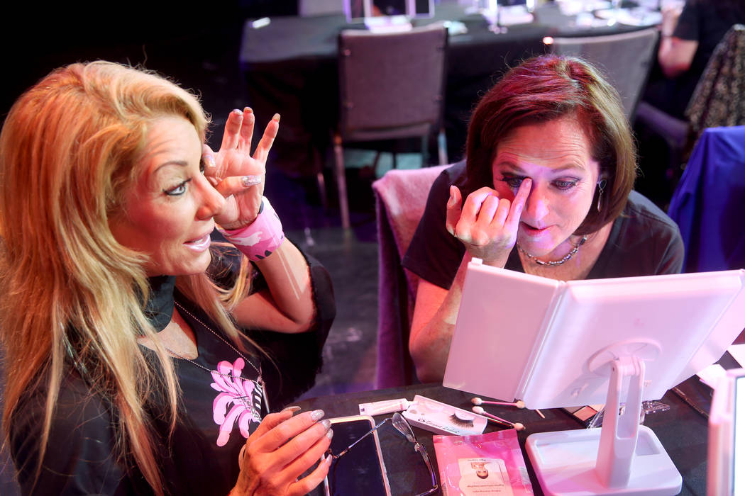 Coache Gabriella Versace, left, works on eyelashes with Marla Laughlin of Las Vegas during a pr ...
