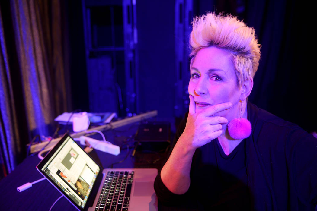 Co-creator Mistinguett prepares before and after photos during a preview of Showgirl Bootcamp a ...