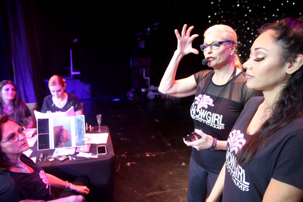 Co-creator Stacy Law-Blind, second from right, teaches makeup using Denise Orozco, right, on st ...