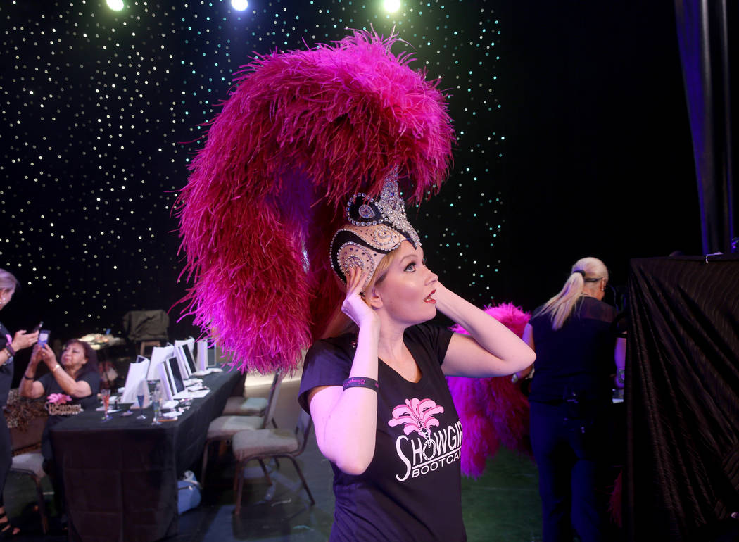 Jacqueline Hill of Henderson dons a dons a showgirl headdress during a preview of Showgirl Boot ...