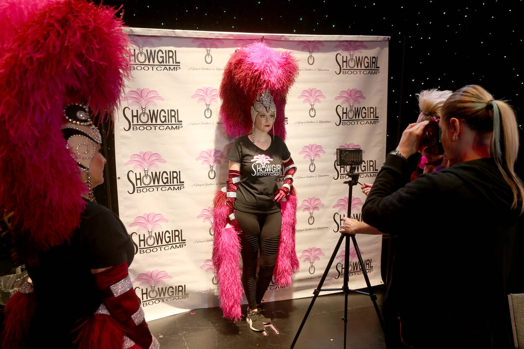 Jacqueline Hill of Henderson gets her photo taken during a preview of Showgirl Bootcamp at Saxe ...