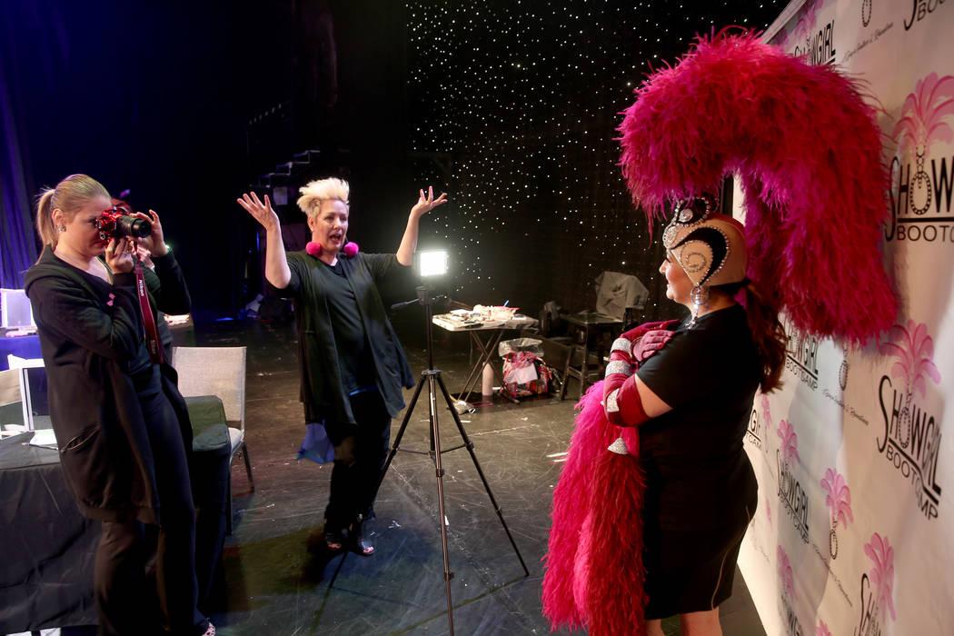 Co-creator Mistinguett, center, helps pose Glenda Damien of Las Vegas as coach Alison Scheel ta ...
