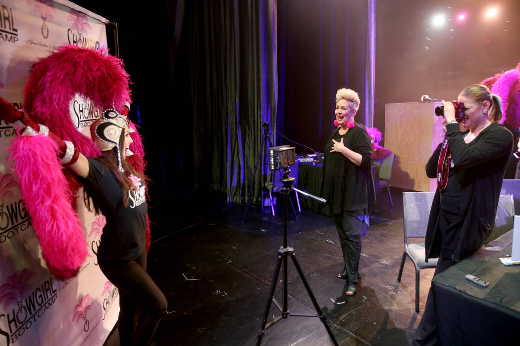 Co-creator Mistinguett, center, helps pose Christi Ahnee of Las Vegas as coach Alison Scheel ta ...