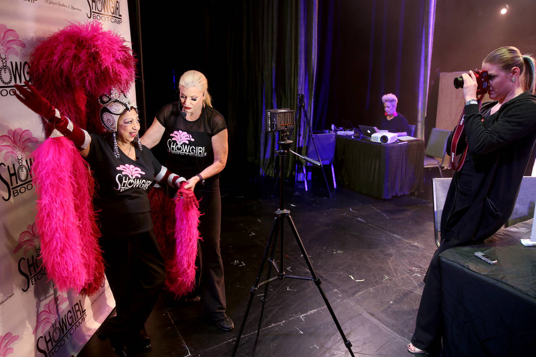 Co-creator Stacy Law-Blind, right, prepares Gita Saval of Las Vegas for her photo shoot as coac ...