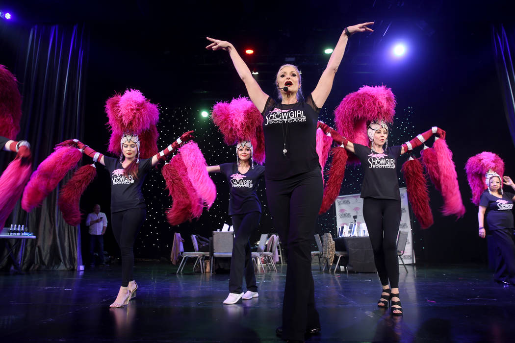 Co-creator Stacy Law-Blind, foreground, teaches the showgirl walk to, from left, Marianne Tanad ...