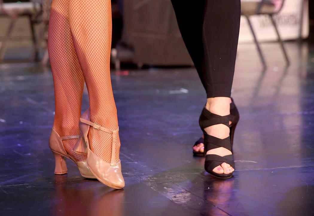 Coach Jennifer Jordan, demonstrates showgirl foot position toTammy Wadsworth of Henderson durin ...