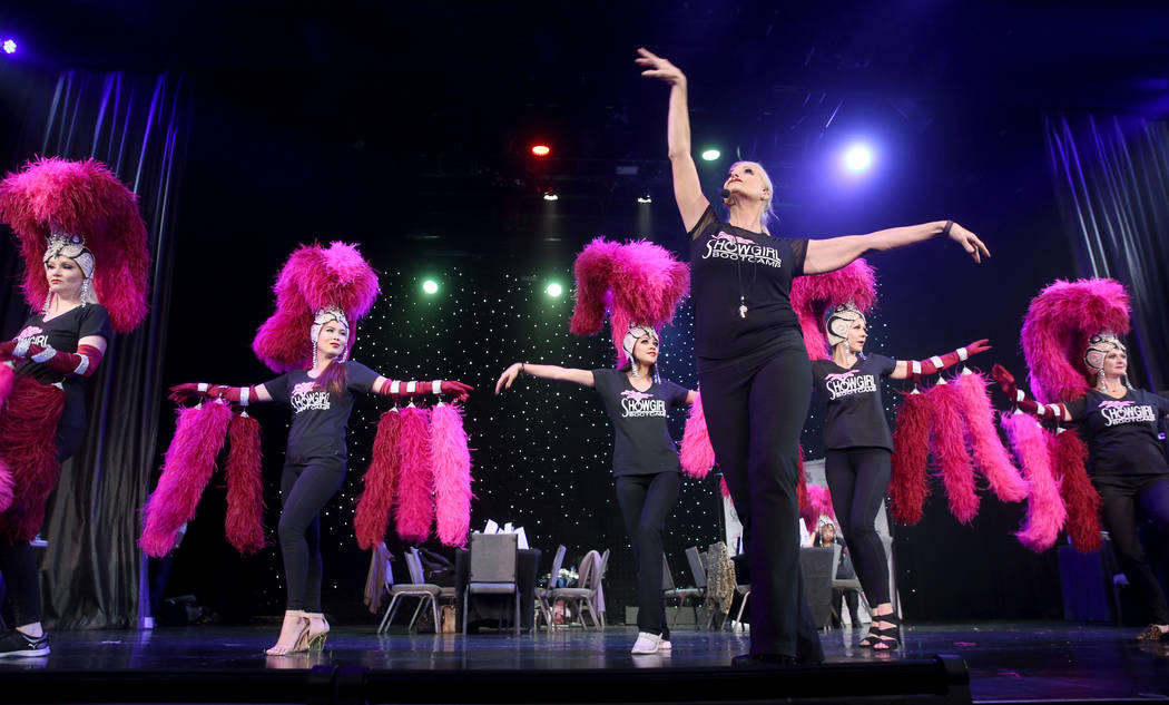 Co-creator Stacy Law-Blind, foreground, teaches the showgirl walk to, from left, Jacqueline Hil ...