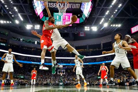Toronto Raptors' Kawhi Leonard shoots past Milwaukee Bucks' Brook Lopez during the second half ...