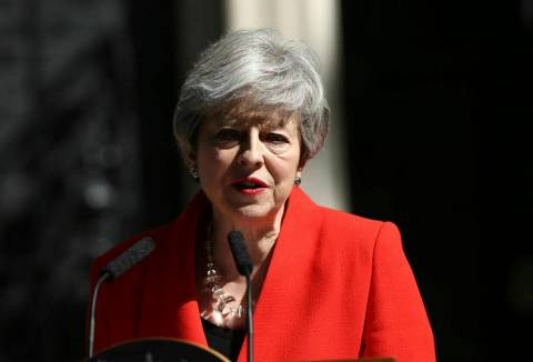 Britain's Prime Minister Theresa May makes a statement outside at 10 Downing Street in London, ...