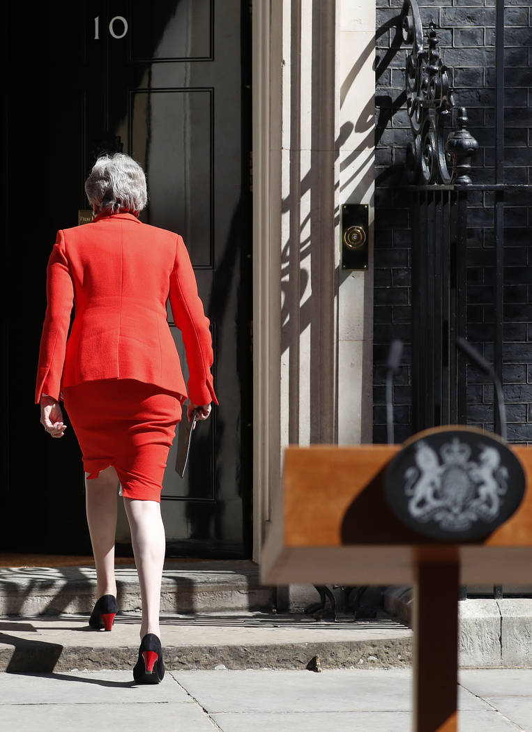 British Prime Minister Theresa May walks away after making a speech in the street outside 10 Do ...