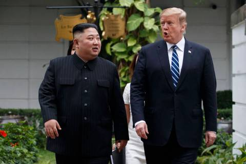 In a Feb. 28, 2019, file photo, President Donald Trump and North Korean leader Kim Jong Un take ...