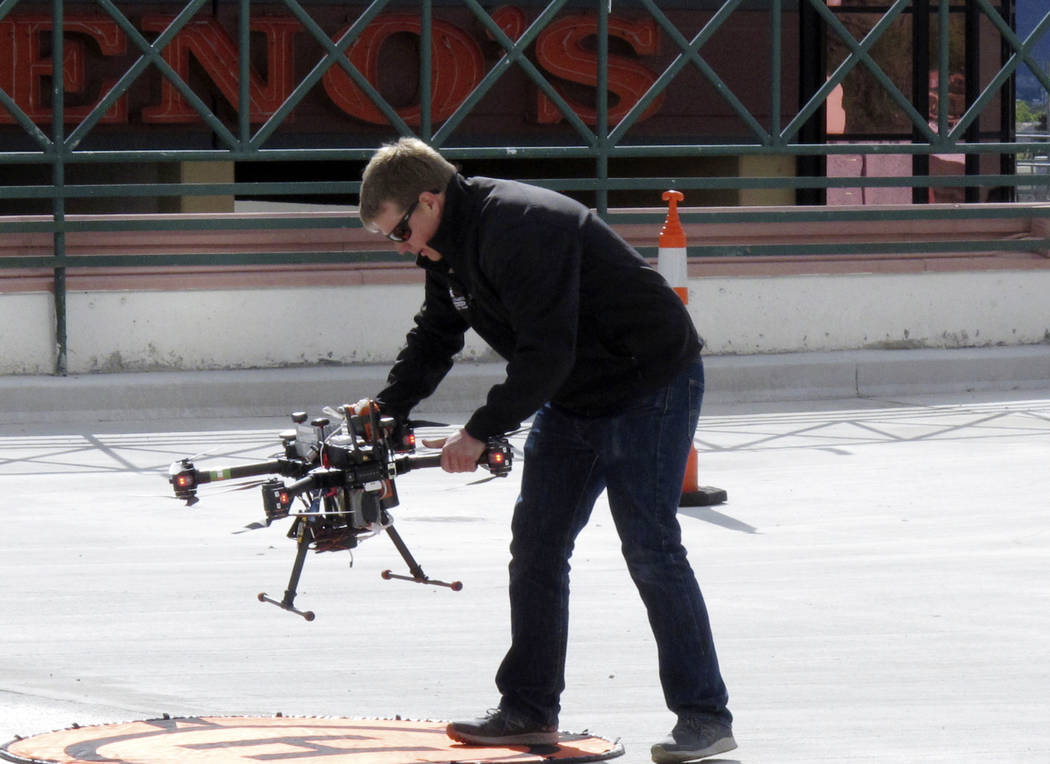 In this Tuesday, May 21, 2019 photo, a researcher positions a drone for take off on the roof o ...