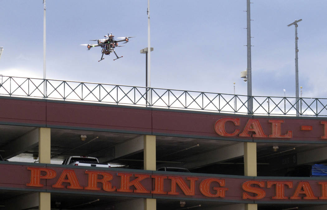In this May 21, 2019 photo, a drone flies over downtown Reno, Nev., before landing on the Cal-N ...