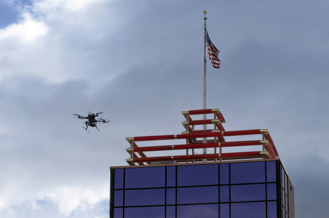 In this Tuesday, May 21, 2019 photo, a drone flies over downtown Reno, Nev., before landing on ...
