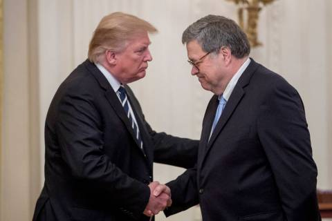 President Donald Trump and Attorney General William Barr shake hands during a Public Safety Off ...