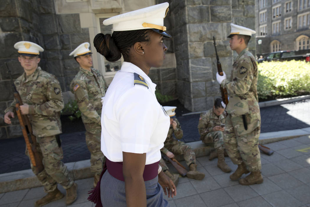 In this May 22, 2019 photo, senior cadet Stephanie Riley, of Jacksonville, Fla., walks across c ...