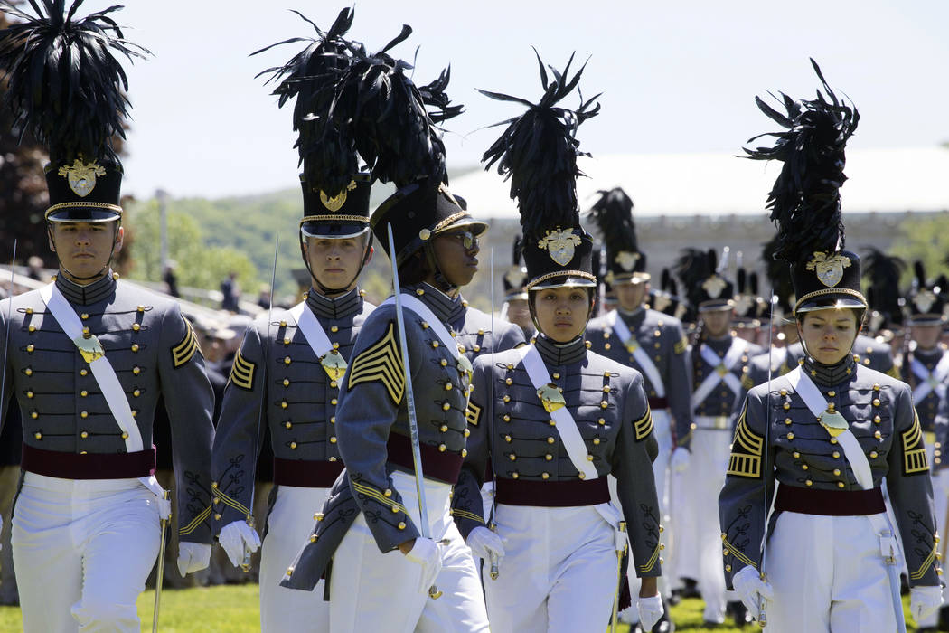 In this May 22, 2019 photo, cadet Isabella Minter, center, marches with senior class members du ...