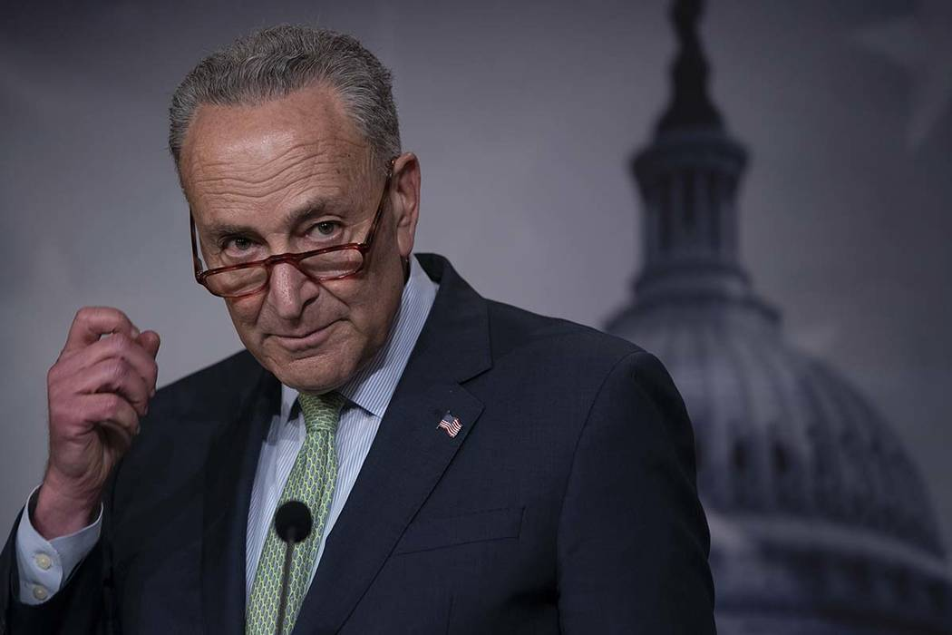 Senate Minority Leader Chuck Schumer, D-N.Y., talks to reporters just after the Senate passed a ...