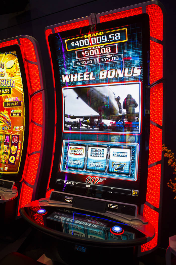 """TwinStar slot cabinets with a curved 75"""" display and 4K resolution at the Scientific Games ..."""