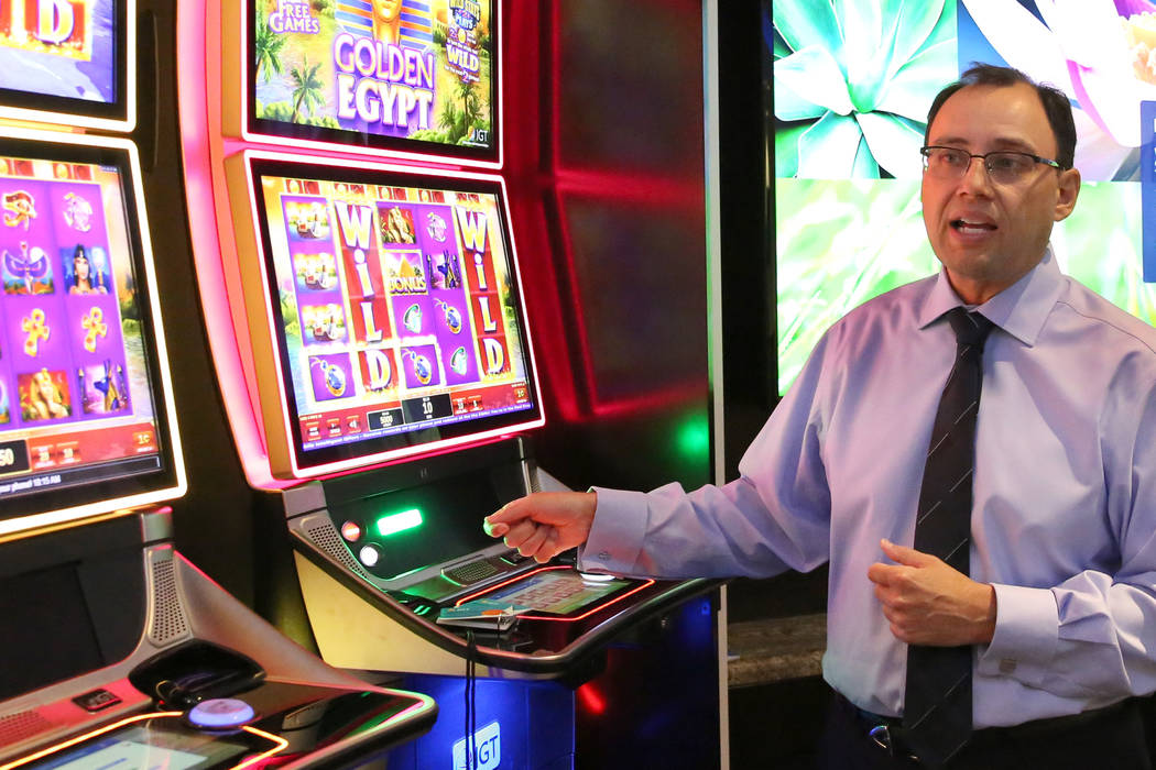 Nick Khin, chief commercial officer at International Game Technology, demonstrates how the new ...