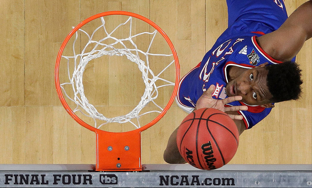 Kansas's Silvio De Sousa (22) watches his shot during the first half in the semifinals of the F ...