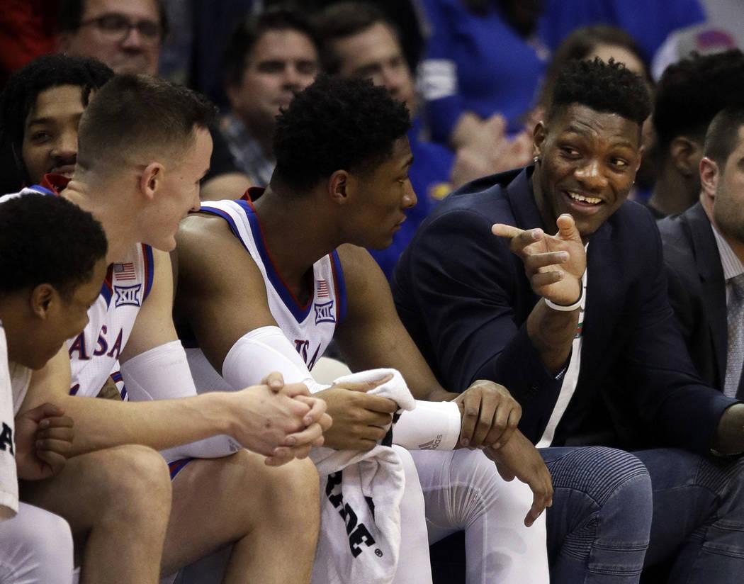 Kansas forward Silvio De Sousa, right, points to teammates during the second half of an NCAA co ...