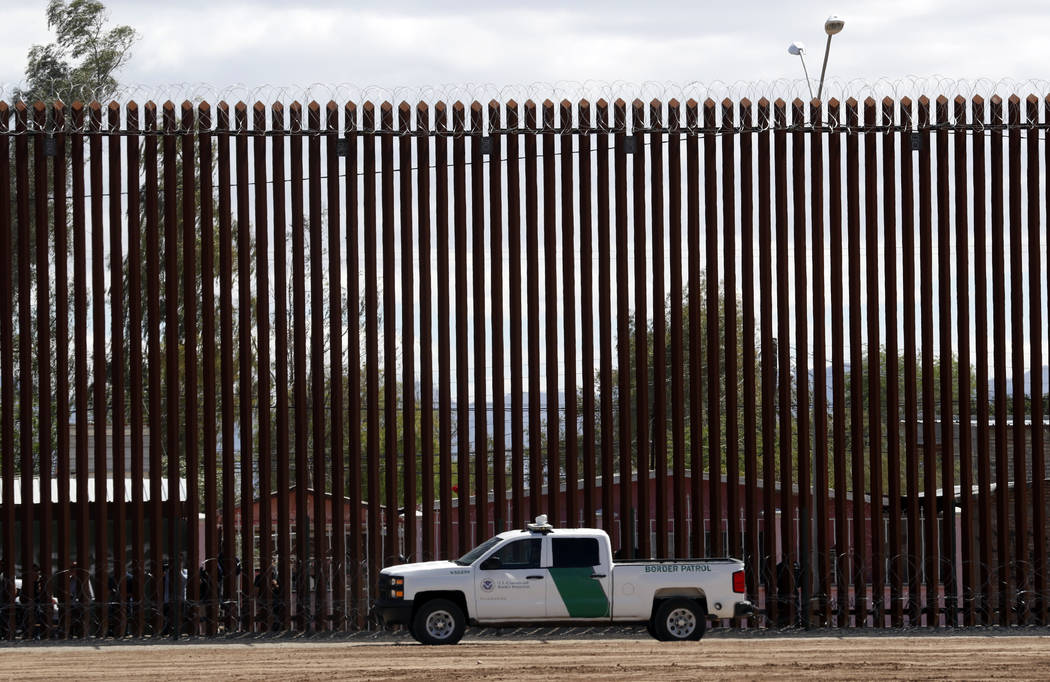 In a April 5, 2019, file photo, a U.S. Customs and Border Protection vehicle sits near the wall ...