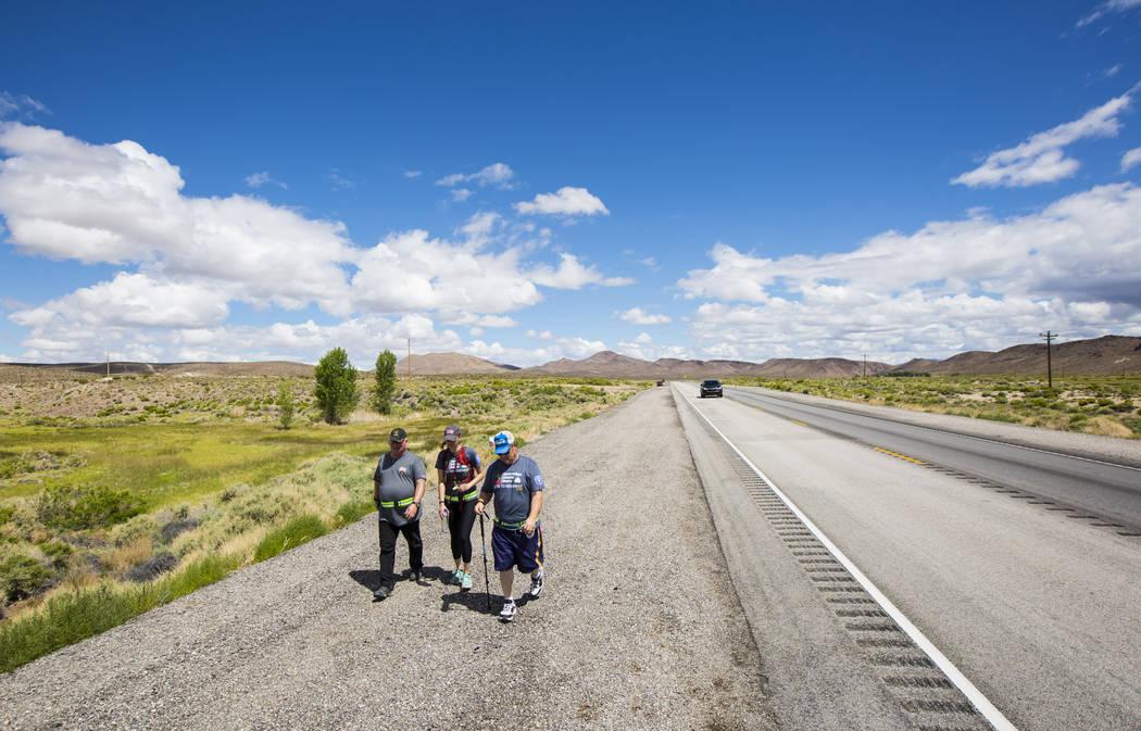 Volunteer Kaci Schroeder, center, of Las Vegas, joins veterans Ross Bryant, director of UNLV's ...