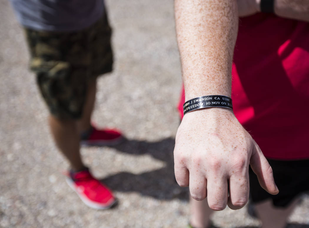 Sean Brown, president of UNLV Rebel Vets, shows a wristband memorializing a fallen friend while ...