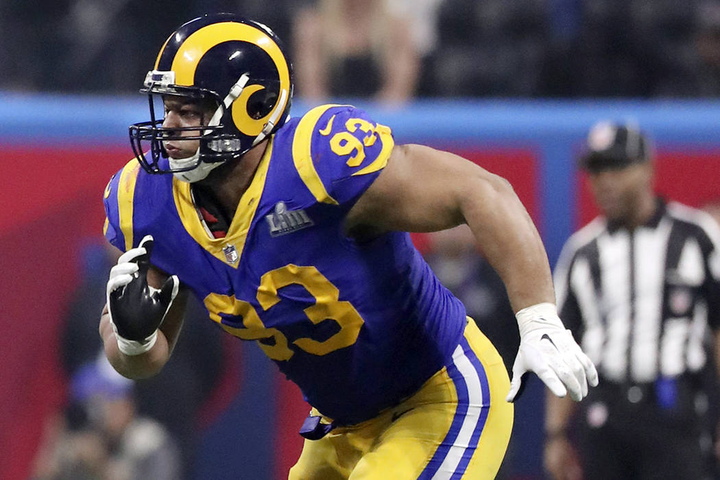 In this Feb. 3, 2019, file photo, Los Angeles Rams' Ndamukong Suh chases the action during NFL ...