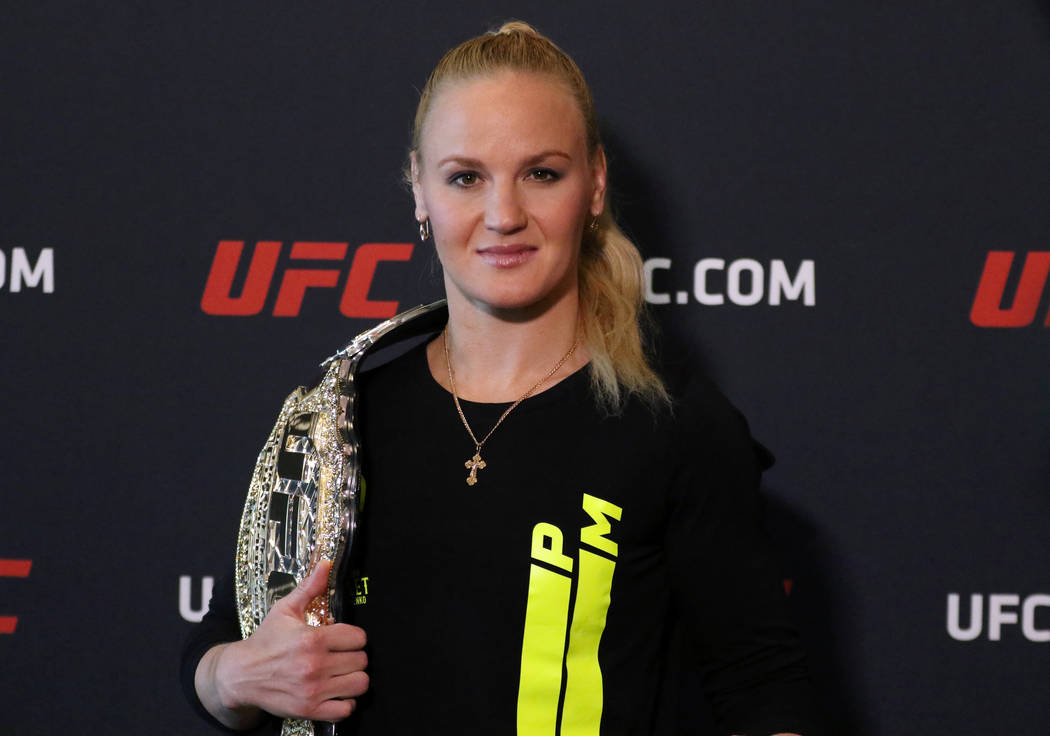 UFC women's flyweight champion Valentina Shevchenko poses with her belt at a media event at the ...